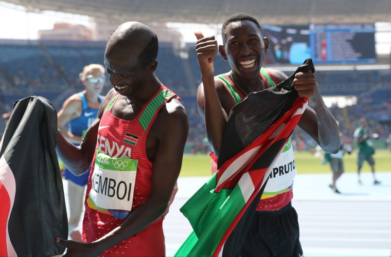 Gold medal winner Kenya's Conseslus Kipruto, right, and bronze medal winner Kenya's Ezekiel Kemboi celebrate after the men's 3000-meter steeplechase final during the athletics competitions of the 2016 Summer Olympics at the Olympic stadium in Rio de Janeiro, Brazil, Wednesday, Aug. 17, 2016. (AP Photo/Lee Jin-man)