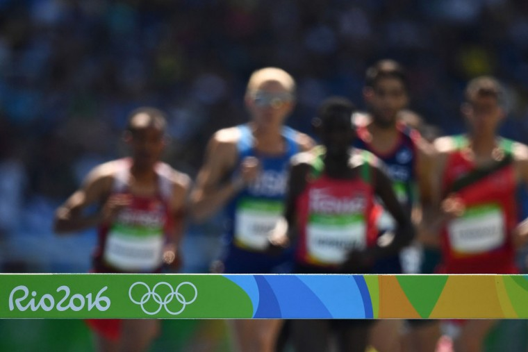 Athletes compete in the Men's 3000m Steeplechase Final during the athletics event at the Rio 2016 Olympic Games at the Olympic Stadium in Rio de Janeiro on August 17, 2016. (JEWEL SAMAD/AFP/Getty Images)