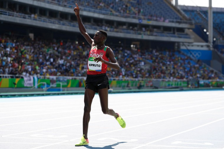 Kenya's Conseslus Kipruto wins the Men's 3000m Steeplechase Final during the athletics event at the Rio 2016 Olympic Games at the Olympic Stadium in Rio de Janeiro on August 17, 2016. (ADRIAN DENNIS/AFP/Getty Images)