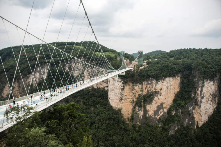 The world's highest and longest glass-bottomed bridge is seen above a valley in Zhangjiajie in China's Hunan Province on August 21, 2016. (FRED DUFOUR/AFP/Getty Images)
