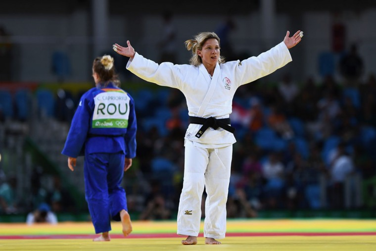 Telma Monteiro of Portugal (white) celebrates after defeating Corina Caprioriu of Romania in the Women's -57 kg Contest for Bronze Medal A on Day 3 of the Rio 2016 Olympic Games at Carioca Arena 2 on August 8, 2016 in Rio de Janeiro, Brazil. (Photo by David Ramos/Getty Images)