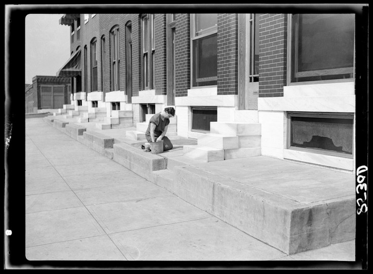 July 1938, scrubbing white steps in Baltimore. (John Vanchon/Farm Security Administration, photo courtesy of LOC archives)