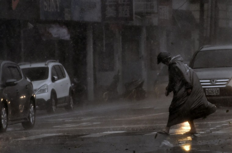 A man walks during a storm in Xindian district, New Taipei City, as Typhoon Megi hit eastern Taiwan on September 27, 2016. Taiwan went into shutdown on September 27 as the island faces its third typhoon in two weeks, with thousands evacuated, schools and offices closed across the island and hundreds of flights disrupted. (SAM YEH/AFP/Getty Images)