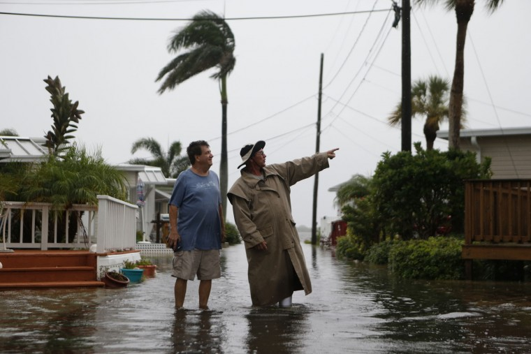 Residents of the Sandpiper Resort survey the rising water coming from the Gulf of Mexico into their neighborhood as winds and storm surge associated with Tropical Storm Hermine impact the area on September 1, 2016 at in Holmes Beach, Florida. Hurricane warnings have been issued for parts of Florida's Gulf Coast as Hermine is expected to make landfall as a Category 1 hurricane. (Photo by Brian Blanco/Getty Images)