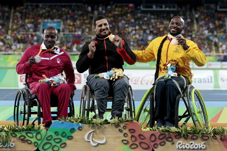 Silver medalist Abdulrahman Abdulqadir Abdulrahman of Qatar, gold medalist Azeddine Nouiri of Morocco and bronze medalist Mauricio Valencia of Colombia celebrate on the podium at the medal ceremony for the Men's Shot Put F34 Final during day four of the Rio 2016 Paralympic Games at the Olympic Stadium on Sunday in Rio de Janeiro, Brazil. (Alexandre Loureiro/Getty Images)