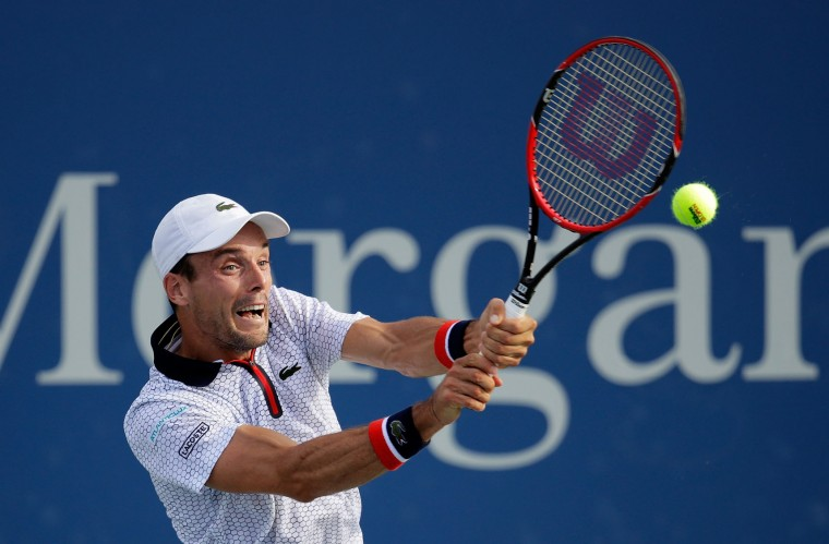 Roberto Bautista Agut of Spain returns a shot to Lucas Pouille of France during his third round Men's Singles match on Day Five of the 2016 US Open at the USTA Billie Jean King National Tennis Center on September 2, 2016 in the Flushing neighborhood of the Queens borough of New York City. (Photo by Andy Lyons/Getty Images)