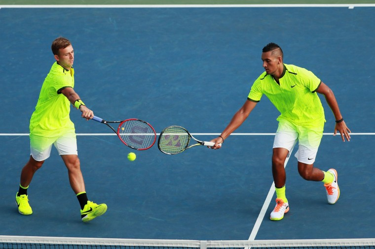 Daniel Evans of Great Britan (L) and Nick Kyrgios of Australia in action against Taylor Fritz and Tommy Paul of the United States during his second round Men's Doubles match on Day Five of the 2016 US Open at the USTA Billie Jean King National Tennis Center on September 2, 2016 in the Flushing neighborhood of the Queens borough of New York City. (Photo by Michael Reaves/Getty Images)