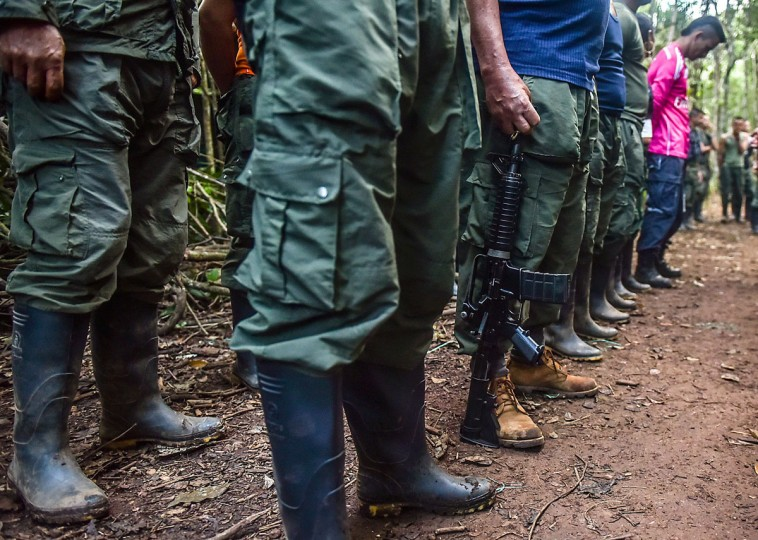 View of the Revolutionary Armed Forces of Colombia (FARC) camp during the 10th National Guerrilla Conference in Llanos del Yari, Caqueta department, Colombia, on September 22, 2016. After 52 years of armed conflict, FARC rebels open what leaders hope will be their last conference as a guerrilla army, where they are due to vote on a historic peace deal with the Colombian government / (AFP Photo/Luis )