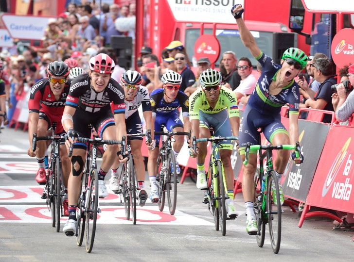 "Orica Bikeexchange's Norwegian cyclist Magnus Cort Nielsen (R) celebrates winning as he crosses the finish line during the 18th stage of the 71st edition of ""La Vuelta"" Tour of Spain, a 191km route Requena to Gandia, on September 8, 2016. (Jose Jordan/AFP/Getty Images)"