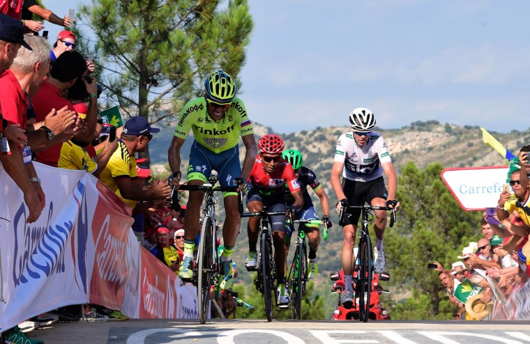 "Tinkoff's Spanish cyclist Alberto Contador (L), Movistar's Colombian cyclist Nairo Quintana and Sky's British cyclist Christopher Froome cross the finish line of the 17th stage of the 71st edition of ""La Vuelta"" Tour of Spain, a 173.3km route Castellon to Llucena, on September 7, 2016. (Jose Jordan/AFP/Getty Images)"