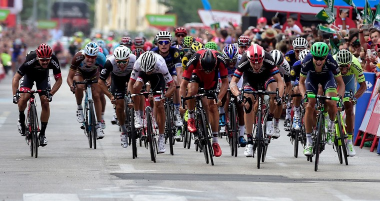 "The pack sprints near the finish line during the 18th stage of the 71st edition of ""La Vuelta"" Tour of Spain, a 191km route Requena to Gandia, on September 8, 2016. (Jose Jordan/AFP/Getty Images)"