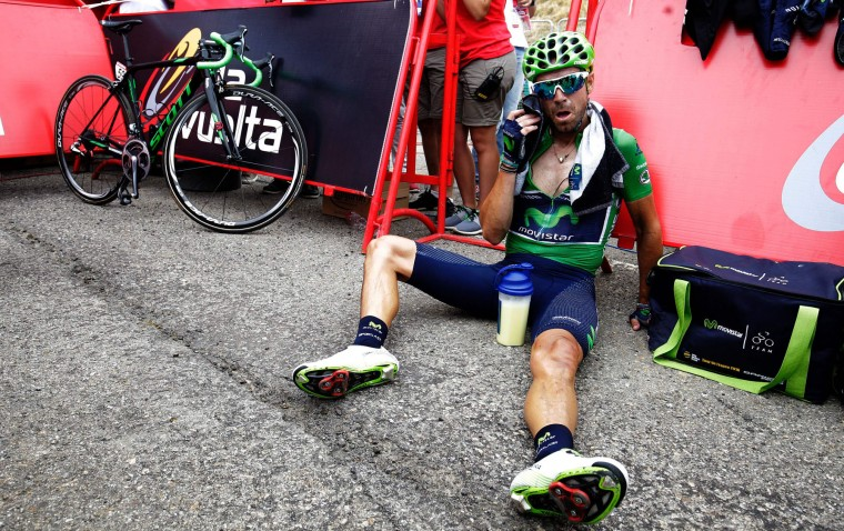 "Movistar's Spanish cyclist Alejandro Valverde sits on the ground after the 15th stage of the 71st edition of ""La Vuelta"" Tour of Spain, a 120km route Sabinanigo to Formigal, on September 4, 2016. (Jose Jordan/AFP/Getty Images)"