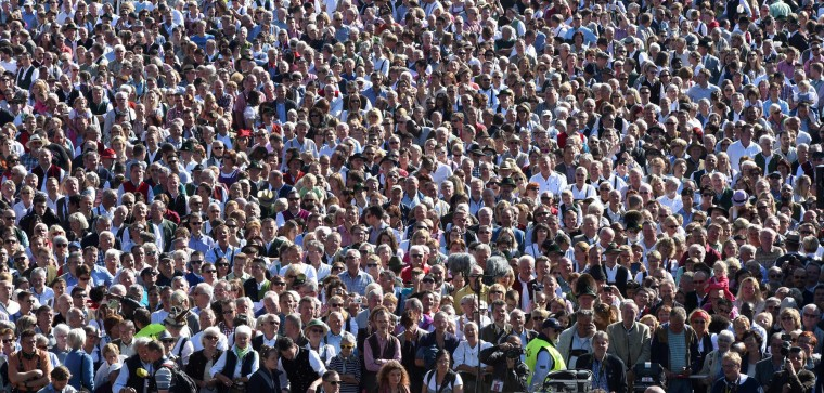 Spectators follow the brass musician concert at the Theresienwiese Oktoberfest fair grounds in Munich, southern Germany, on September 25, 2016. The world's biggest beer festival Oktoberfest runs until October 3, 2016. (Christof Stache/AFP/Getty Images)