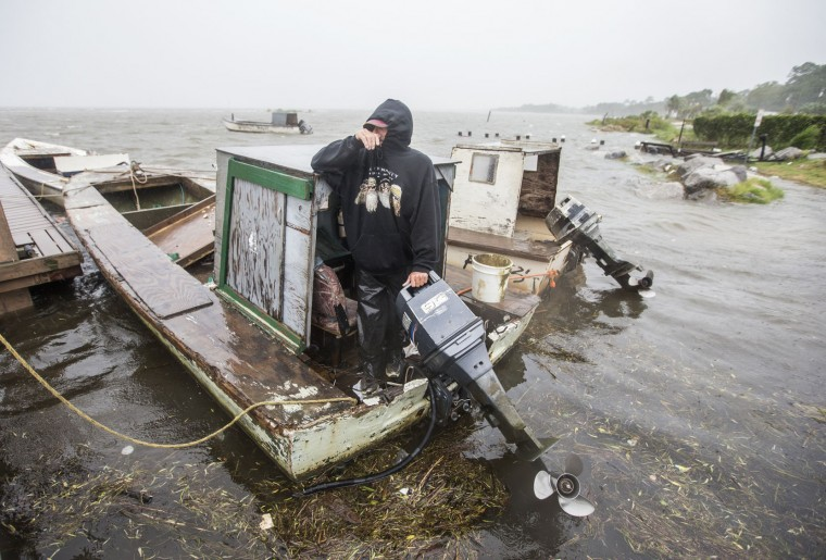 Oysterman Leon Irvin watches the storm surge and winds pick up while checking on his boats as Hurricane Hermine approaches on September 1, 2016 in Eastpoint, Florida. Hurricane warnings have been issued for parts of Florida's Gulf Coast as Hermine is expected to make landfall as a Category 1 hurricane. (Photo by Mark Wallheiser/Getty Images)