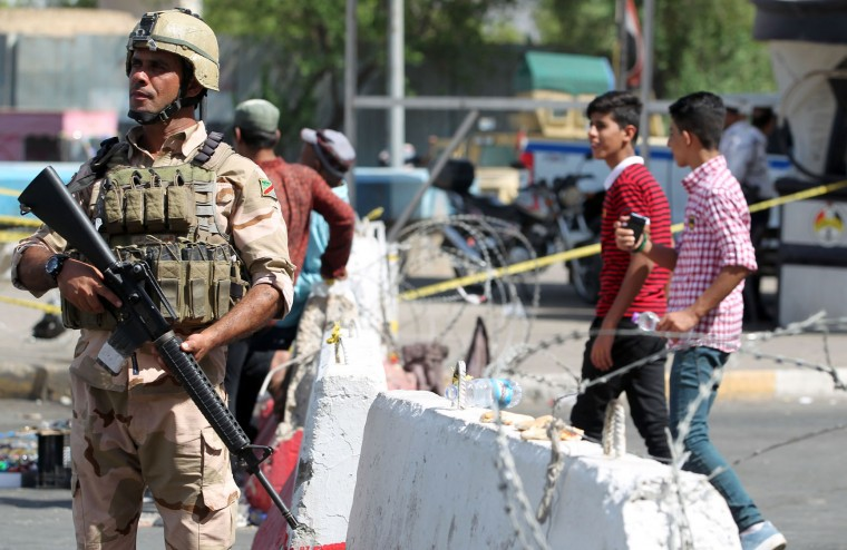 Iraqi soldiers stand guard near Zawraa Park during increased security measures as Iraqis celebrate the Eid al-Adha (Feast of the Sacrifice) holiday in the capital Baghdad on September 13, 2016. (Ahmad Al-Rubaye/AFP/Getty Images)