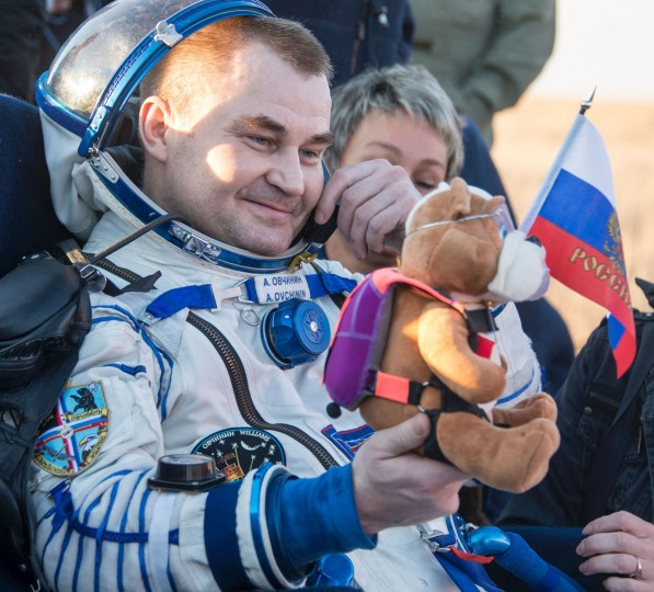 Russian cosmonaut Alexey Ovchinin of Roscosmos rests in a chair outside the Soyuz TMA-20M spacecraft a few moments after he and NASA astronaut Jeff Williams, and Russian cosmonaut Oleg Skripochka of Roscosmos landed in a remote area near the town of Zhezkazgan, Kazakhstan onon Wednesday, September 7, 2016 (Kazakh time). Williams, Ovchinin, and Skripochka are returning after 172 days in space where they served as members of the Expedition 47 and 48 crews onboard the International Space Station. The Soyuz TMA-20M spacecraft is seen as it lands with Expedition 48 crew members, NASA astronaut Jeff Williams, Russian cosmonauts Alexey Ovchinin, and Oleg Skripochka of Roscosmos near the town of Zhezkazgan, Kazakhstan on Wednesday, September 7, 2016(Kazakh time). Williams, Ovchinin, and Skripochka are returning after 172 days in space where they served as members of the Expedition 47 and 48 crews onboard the International Space Station. (AFP PHOTO / NASA / BILL INGALLS)