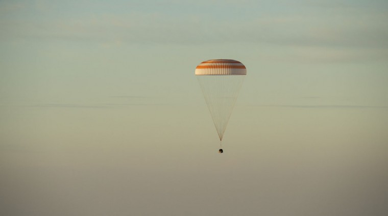 The Soyuz TMA-20M spacecraft is seen as it lands with Expedition 48 crew members, NASA astronaut Jeff Williams, Russian cosmonauts Alexey Ovchinin, and Oleg Skripochka of Roscosmos near the town of Zhezkazgan, Kazakhstan on Wednesday, September 7, 2016(Kazakh time). Williams, Ovchinin, and Skripochka are returning after 172 days in space where they served as members of the Expedition 47 and 48 crews onboard the International Space Station. (AFP PHOTO / NASA / BILL INGALLS)