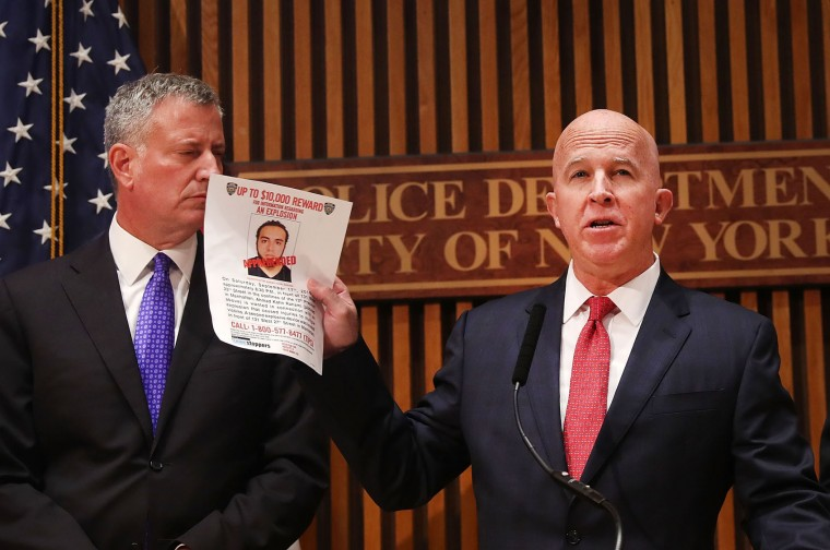 New York City police commissioner James O'Neill holds up a picture of Ahmad Khan Rahami, the man believed to be responsible for the explosion in Manhattan on Saturday night and an earlier bombing in New Jersey, at a news conference at New York City on September 19, 2016 in New York City. Rahami was taken into custody on Monday afternoon following a gunfight where he was wounded by he police. (Photo by Spencer Platt/Getty Images)