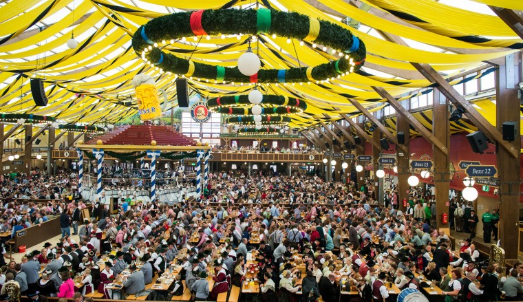 Members of traditional Bavarian costume associations (Trachtenverein), Bavarian bands and riflemen's associations have taken place in the Paulaner beer tent after they have participated in the annual riflemen's parade during day 2 of the 2016 Oktoberfest beer festival at Theresienwiese on September 18, 2016 in Munich, Germany. The 2016 Oktoberfest is taking place under heightened security due to fears over international terrorism. The fest will be open to the public through October 3. (Photo by Joerg Koch/Getty Images)