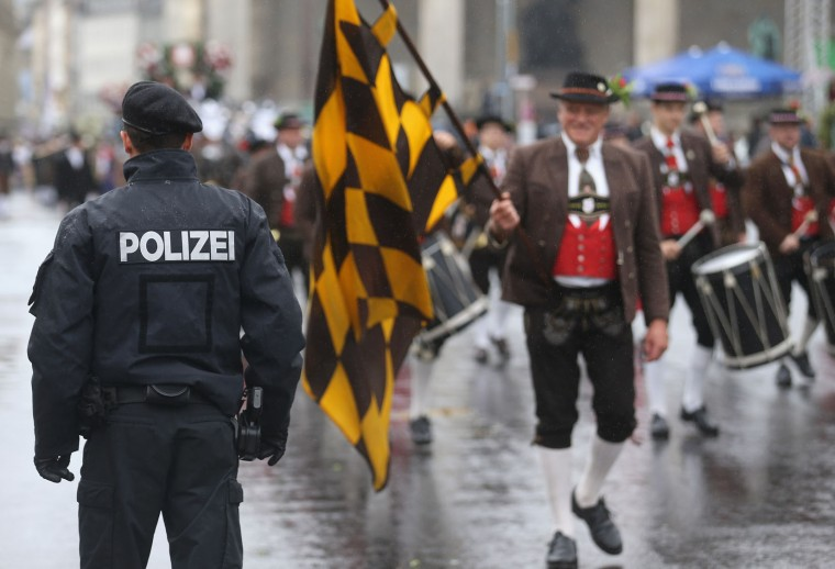 Riot police watch the traditional Bavarian riflemen's parade during day 2 of the Oktoberfest 2016 beer festival on September 18, 2016 in Munich, Germany. The 2016 Oktoberfest is taking place under heightened security due to fears over international terrorism. The fest will be open to the public through October 3. (Photo by Johannes Simon/Getty Images)