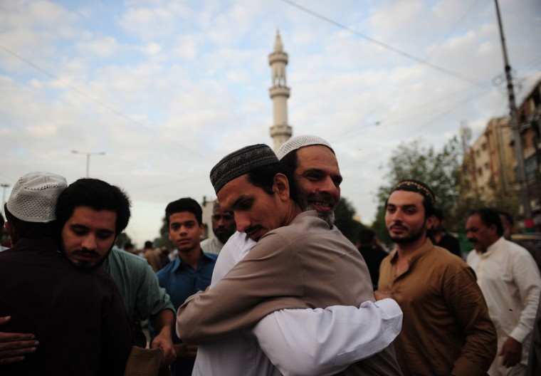 Pakistani Muslim hug each other after attending Eid al-Adha prayers at a mosque in Karachi on September 13, 2016. Muslims across the world celebrate the annual festival of Eid al-Adha, or the Festival of Sacrifice, which marks the end of the Hajj pilgrimage to Mecca and in commemoration of Prophet Abraham's readiness to sacrifice his son to show obedience to God. (Asif Hassan/AFP/Getty Images)