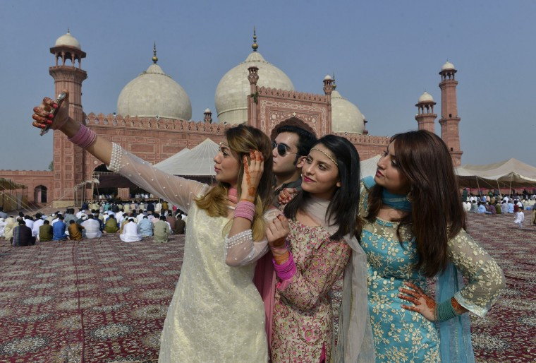 Pakistani Muslims pose for selfie after attending Eid al-Adha prayers in Lahore on September 13, 2016. Muslims across the world celebrate the annual festival of Eid al-Adha, or the Festival of Sacrifice, which marks the end of the Hajj pilgrimage to Mecca and in commemoration of Prophet Abraham's readiness to sacrifice his son to show obedience to God. (Arif Ali/AFP/Getty Images)