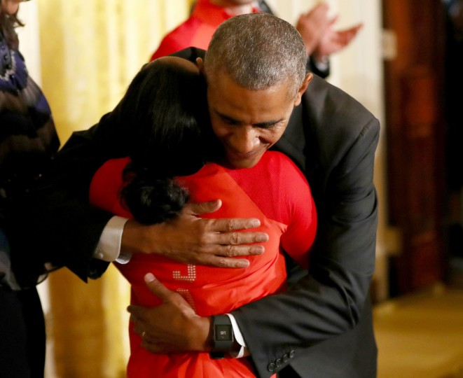 WASHINGTON, DC - SEPTEMBER 29: U.S. President Barack Obama hugs Olympian Simone Biles during an East Room event at the White House September 29, 2016 in Washington, DC. President Obama and first lady Michelle Obama welcome the 2016 U.S. Olympic and Paralympic teams to the White House to honor their participation and success in the Rio Olympic Games this year. (Photo by Elsa/Getty Images)