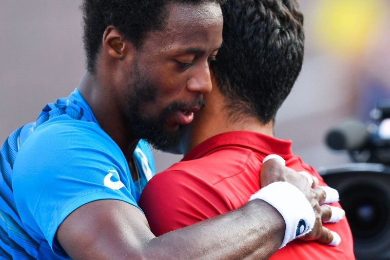 Gael Monfils of France hugs Nicolas Almagro of Spain after defeating him during their 2016 US Open Men's Singles match at the USTA Billie Jean King National Tennis Center in New York on September 2, 2016. / (Eduardo Munoz Alvarez/AFP/Getty Images)