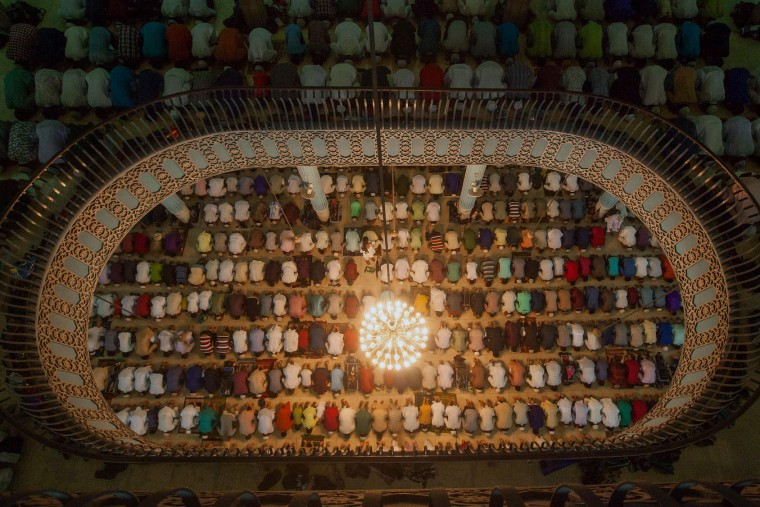 Bangladeshi Muslims attend Eid al-Adha prayers at Baitul Mukarrom National Mosque in Dhaka on September 13, 2016. Muslims across the world celebrate the annual festival of Eid al-Adha, or the Festival of Sacrifice, which marks the end of the Hajj pilgrimage to Mecca and in commemoration of Prophet Abraham's readiness to sacrifice his son to show obedience to God. (AFP/Getty Images)