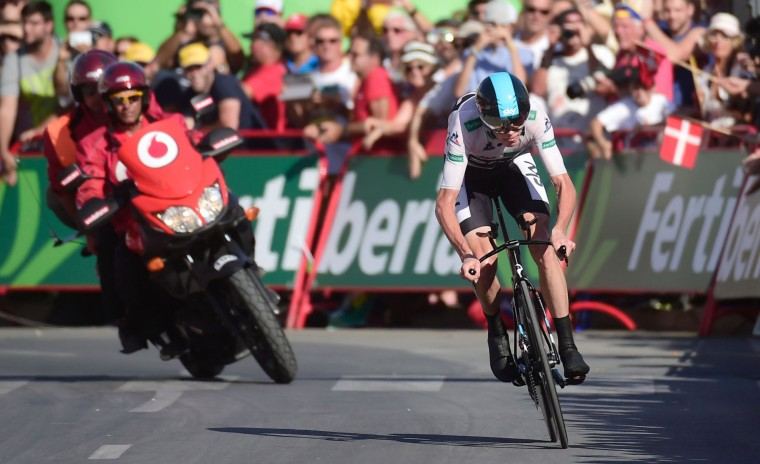 "Sky's British cyclist Christopher Froome approaches the finish line to win the 19th stage of the 71st edition of ""La Vuelta"" Tour of Spain, a 39km individual time-trial between Javea and Calpe on September 9, 2016. Orica Bikeexchange's Danish cyclist Magnus Cort Nielsen (R) celebrates winning as he crosses the finish line during the 18th stage of the 71st edition of ""La Vuelta"" Tour of Spain, a 191km route from Requena to Gandia, on September 8, 2016. (Jose Jordan/AFP/Getty Images)"