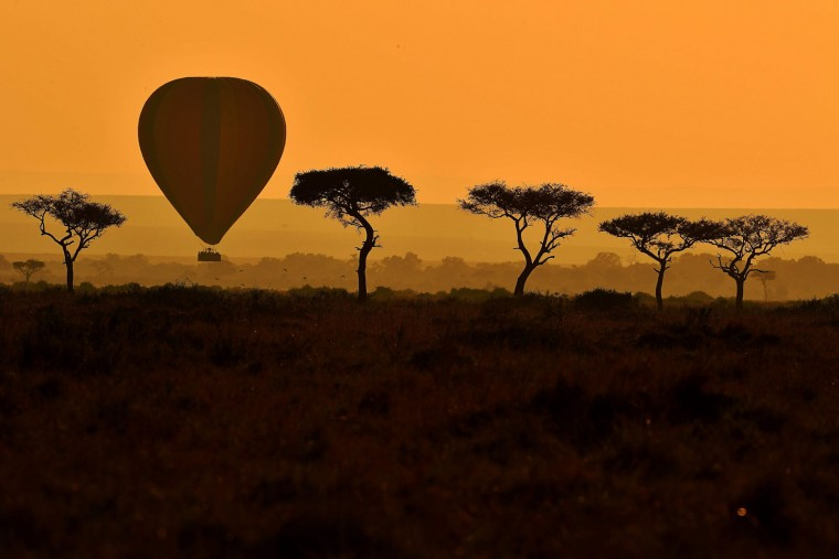 A hot air balloon carrying tourists is pictured during the annual wildebeest migration in the Masai Mara game reserve on September 14, 2016. (Carl de Souza/AFP/Getty Images)