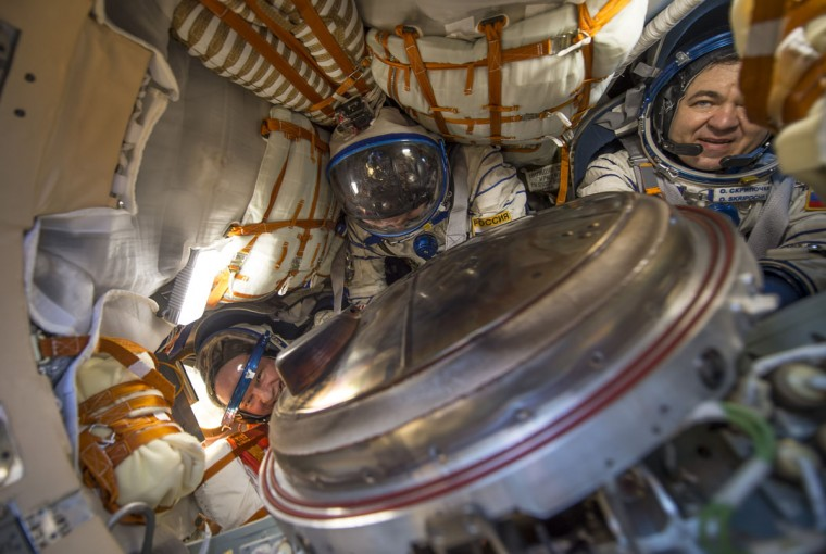 KHEZKAZGAN, KAZAKHSTAN - SEPTEMBER 7: Expedition 48 crew members (L-R) NASA astronaut Jeff Williams and Russian cosmonauts Alexey Ovchinin and Oleg Skripochka of Roscosmos are seen inside the Soyuz TMA-20M spacecraft after landing September 7, 2016 near the town of Zhezkazgan, Kazakhstan. Williams, Ovchinin, and Skripochka are returning after 172 days in space where they served as members of the Expedition 47 and 48 crews onboard the International Space Station. (Photo by Bill Ingalls/NASA via Getty Images)