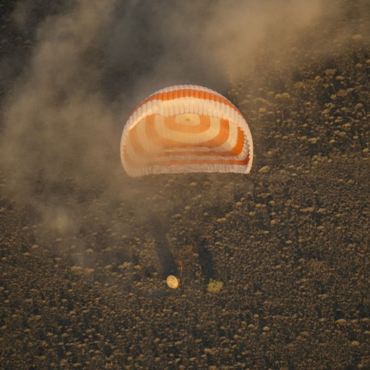 KHEZKAZGAN, KAZAKHSTAN - SEPTEMBER 7: The Soyuz TMA-20M spacecraft is seen as it lands with Expedition 48 crew members NASA astronaut Jeff Williams and Russian cosmonauts Alexey Ovchinin and Oleg Skripochka of Roscosmos September 7, 2016 near the town of Zhezkazgan, Kazakhstan. Williams, Ovchinin, and Skripochka are returning after 172 days in space where they served as members of the Expedition 47 and 48 crews onboard the International Space Station. (Photo by Bill Ingalls/NASA via Getty Images)