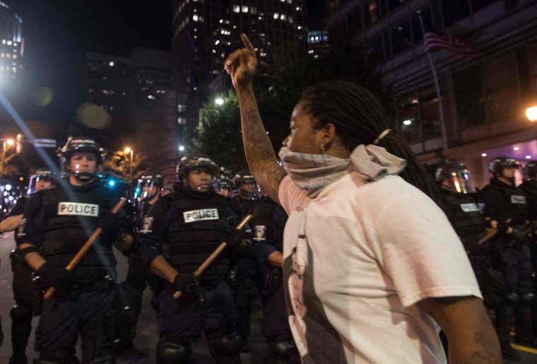 Protesters face riot police during a demonstration against police brutality in Charlotte, North Carolina, on September 21, 2016, following the shooting of Keith Lamont Scott the previous day. A protester in Charlotte, North Carolina was fatally shot by a civilian during a second night of unrest after the police killed a black man, officials said. (Nicholas Kamm/AFP/Getty Images)