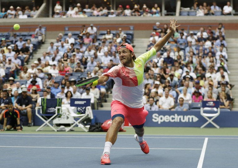 Lucas Pouille, of France, returns a shot to Gael Monfils, of France, during the quarterfinals of the U.S. Open tennis tournament, Tuesday, Sept. 6, 2016, in New York. (AP Photo/Julio Cortez)