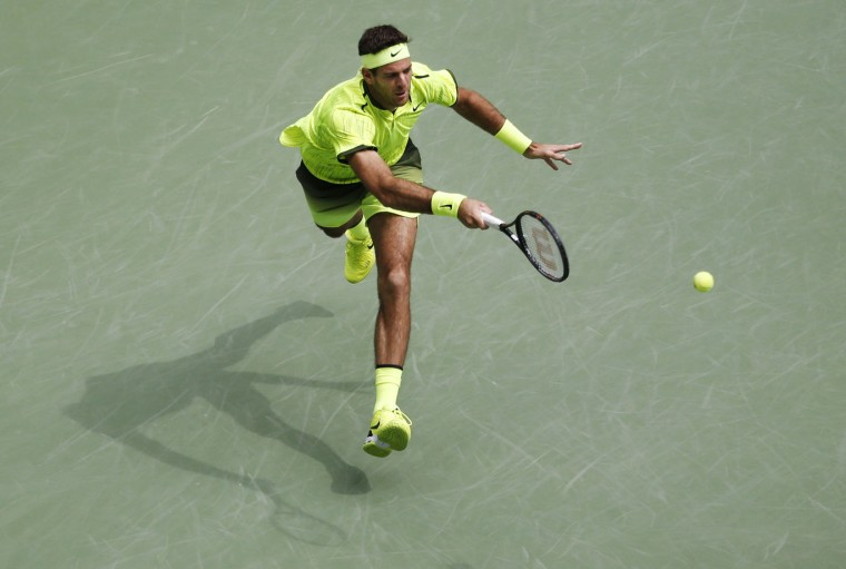 Juan Martin del Potro, of Argentina, returns a shot to Dominic Thiem, of Austria, during the fourth round of the U.S. Open tennis tournament, Monday, Sept. 5, 2016, in New York. (AP Photo/Jason DeCrow)
