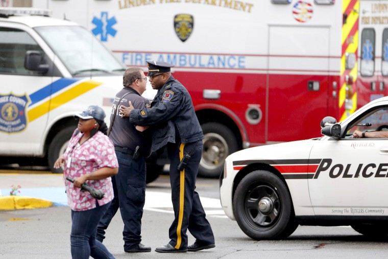 Law enforcement gather outside the emergency room of University Hospital after a shoot out in Linden where officers and terror suspect was Ahmad Khan Rahami were wounded and Rahami was apprehended Monday, Sept. 19, 2016. Newark, NJ, USA (Aristide Economopoulos   NJ Advance Media via AP)