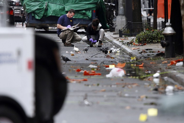 Evidence teams investigate at the scene of Saturday's explosion on West 23rd Street in Manhattan's Chelsea neighborhood, Monday, Sept. 19, 2016, in New York. Ahmad Khan Rahami, wanted in the bombings that rocked Chelsea and a New Jersey shore town was captured Monday after being wounded in a gun battle with police that erupted when he was discovered sleeping in a bar doorway, authorities said. (AP Photo/Jason DeCrow)