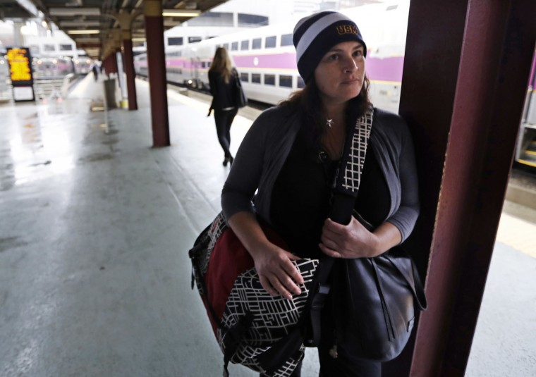 Erin Murphy, 49, of Marshfield, Mass., stands during an interview regarding fears of terrorism while waiting for her train at the South Station, Monday, Sept. 19, 2016, in Boston. Fresh off a weekend in which blasts shook a New York neighborhood and a New Jersey shore town, in which pipe bombs were found in a suburban railroad station, and in which a Minnesota mall became the scene of a string of stabbings, the country started the week wondering whether it was all part of a new normal. (AP Photo/Charles Krupa)