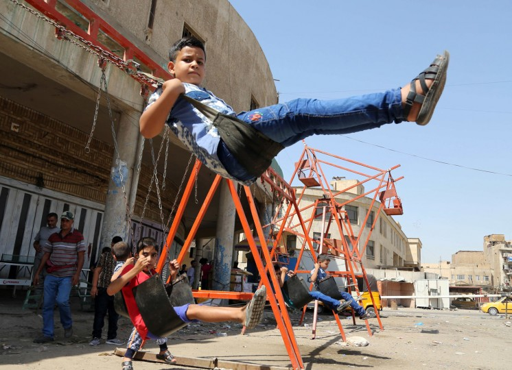 Children play during the second day of the Muslim holiday of Eid al-Adha, in Baghdad, Iraq, Tuesday, Sept. 13, 2016. Muslims around the world are celebrating Eid al-Adha, or the Feast of the Sacrifice to mark the willingness of the Prophet Ibrahim -- Abraham to Christians and Jews -- to sacrifice his son. (AP Photo/Karim Kadim)