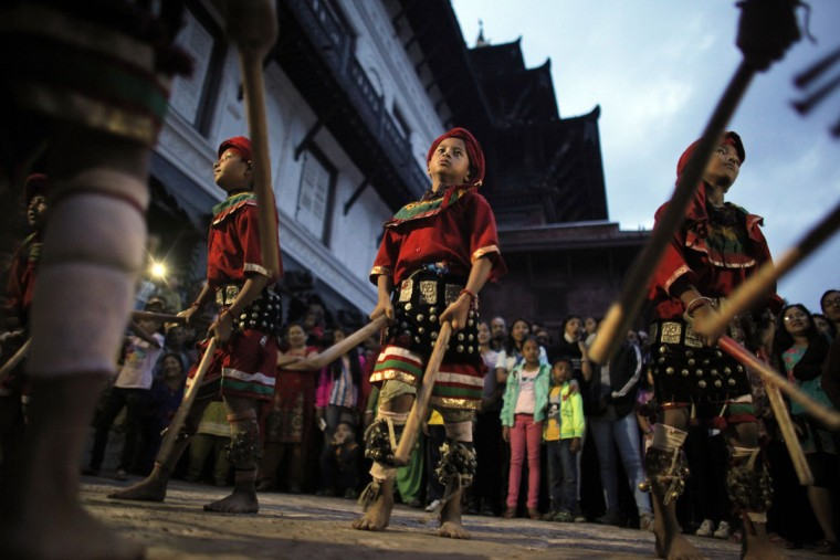 Young Nepalese artists perform during Indra Jatra Festival in Basantapur Durbar Square, Kathmandu, Nepal, Friday, Sept. 16, 2016. Indra is considered the Hindu god of rain and the festival marks the end of the rainy season. (AP Photo/Niranjan Shrestha)