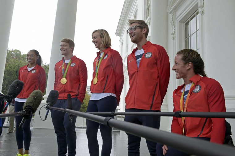 Athletes who participated in the Olympic games in Rio, from left, Olympic runner Allyson Felix, Olympic BMX rider Connor Fields, Olympic swimmer Katie Ledecky, Paralympic Swimmer and Navy veteran Brad Snyder, and Paralympic wheelchair racer Tatyana McFadden, speaks to reporters outside the White House in Washington, Thursday, Sept. 29, 2016, following a ceremony where President Barack Obama honored the Olympics teams. (AP Photo/Susan Walsh)