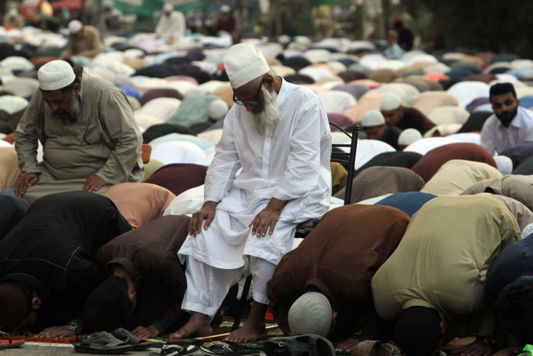 People offer Eid al Adha prayers in Karachi, Pakistan, Tuesday, Sept. 13, 2016. Pakistani Muslims are celebrating Eid al-Adha, or the Feast of the Sacrifice, to mark the willingness of the Prophet Ibrahim -- Abraham to Christians and Jews -- to sacrifice his son. During the holiday Muslims slaughter sheep and cattle, distribute part of the meat to the poor. (AP Photo/Fareed Khan)