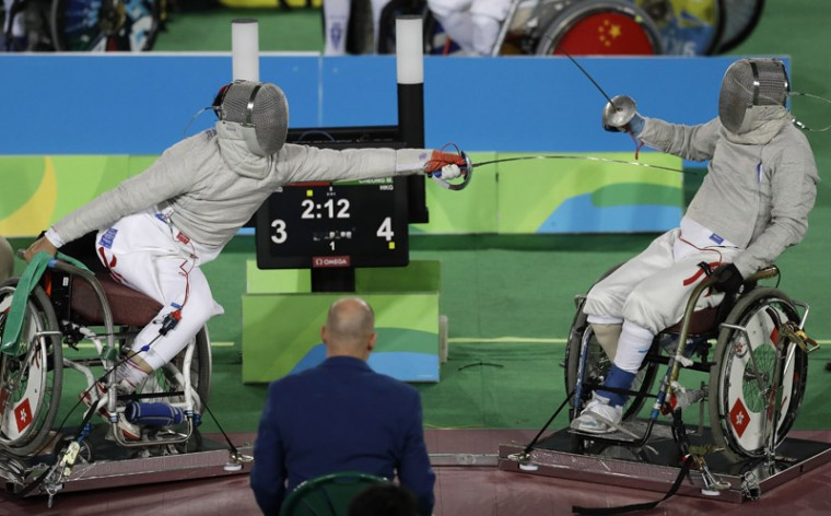 China's Wing Kin Chan, left, and China's Meng Chai Cheong compete in the men's individual sabre, category A, wheelchair fencing event at the Paralympic Games in Rio de Janeiro, Brazil, on Monday. (Leo Correa/AP)