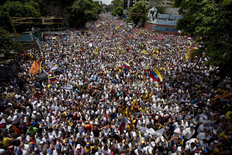 """In this Sept 1, 2016 photo, demonstrators take part in the """"taking of Caracas"""" march in Caracas. Venezuela's opposition is vowing to keep up pressure on President Nicolas Maduro after flooding the streets of Caracas with demonstrators Thursday in its biggest show of force in years. Protesters filled dozens of city blocks in what was dubbed the """"taking of Caracas"""" to pressure electoral authorities to allow a recall referendum against Maduro this year. (AP Photo/Ariana Cubillos)"""