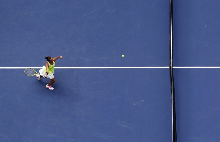 Roberta Vinci, of Italy, returns a shot to Angelique Kerber, of Germany, during the quarterfinals of the U.S. Open tennis tournament, Tuesday, Sept. 6, 2016, in New York. (AP Photo/Julie Jacobson)