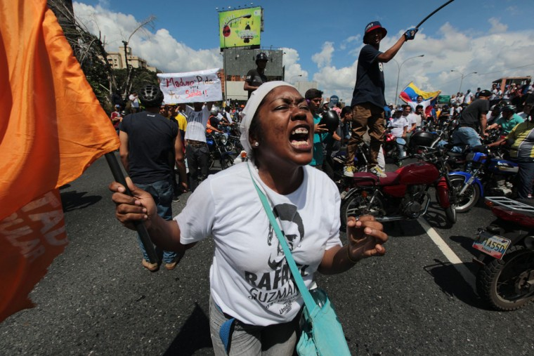 """A demonstrator shouts insults against Venezuela's President Nicolas Maduro during a protest in Caracas, Venezuela, Thursday, Sept. 1, 2016. Venezuela's opposition is vowing to keep up pressure on President Nicolas Maduro after flooding the streets of Caracas with demonstrators Thursday in its biggest show of force in years. Protesters filled dozens of city blocks in what was dubbed the """"taking of Caracas"""" to pressure electoral authorities to allow a recall referendum against Maduro this year. (AP Photo/Fernando Llano)"""