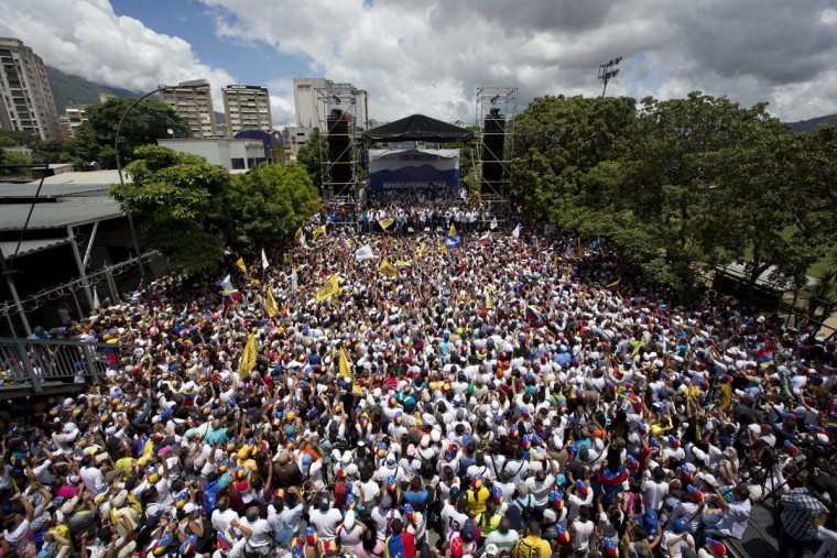 """Demonstrators take part in the """"taking of Caracas"""" march in Caracas, Venezuela, Thursday, Sept. 1, 2016. Venezuela's opposition is vowing to keep up pressure on President Nicolas Maduro after flooding the streets of Caracas with demonstrators Thursday in its biggest show of force in years. Protesters filled dozens of city blocks in what was dubbed the """"taking of Caracas"""" to pressure electoral authorities to allow a recall referendum against Maduro this year. (AP Photo/Ariana Cubillos)"""