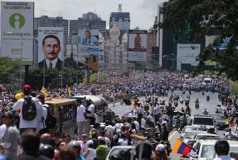 """Demonstrators take part in the """"taking of Caracas"""" march in Caracas, Venezuela, Thursday, Sept 1, 2016. Venezuela's opposition is vowing to keep up pressure on President Nicolas Maduro after flooding the streets of Caracas with demonstrators Thursday in its biggest show of force in years. Protesters filled dozens of city blocks in what was dubbed the """"taking of Caracas"""" to pressure electoral authorities to allow a recall referendum against Maduro this year. (AP Photo/Fernando Llano)"""