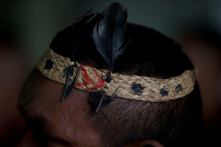 A Piaroa Indian listens to a leader during a meeting, after the group arrived from Amazonas State to attend an opposition protest in Caracas, Venezuela, Wednesday, Aug. 31, 2016. Opponents of President Nicolas Maduro are preparing to flood the streets of Caracas in what is shaping up to be a major test of their strength and the government's ability to tolerate growing dissent. (AP Photo/Fernando Llano)